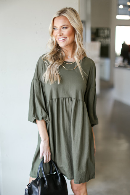 Olive - Model wearing a Puff Sleeve Babydoll Dress
