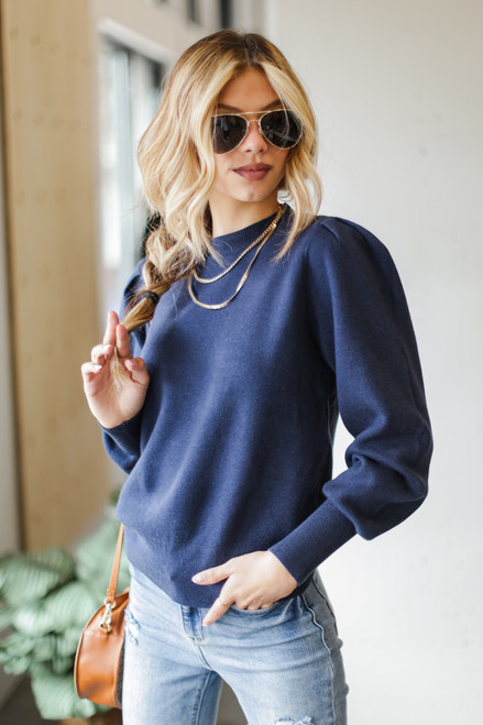 Navy - Model wearing a Puff Sleeve Sweater with jeans