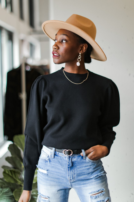 Black - Puff Sleeve Sweater on model with a wide brim hat