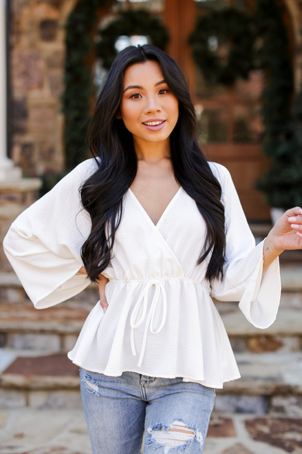 Ivory - Dress Up model wearing a Surplice Peplum Blouse