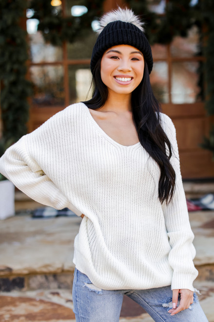 Ivory - Model wearing a Twist Back Sweater