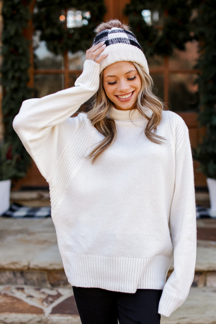 Ivory - Model wearing a Brushed Knit Turtleneck Sweater