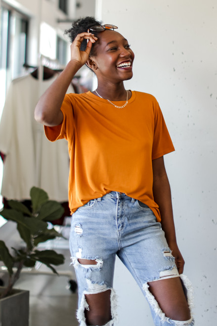 Orange - Model wearing an Ultra Soft Basic Tee with jeans