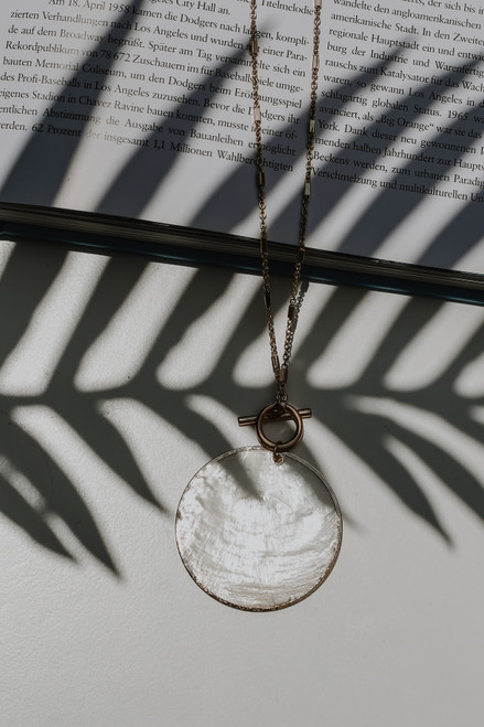 Natural - Flat Lay of a Shell Necklace