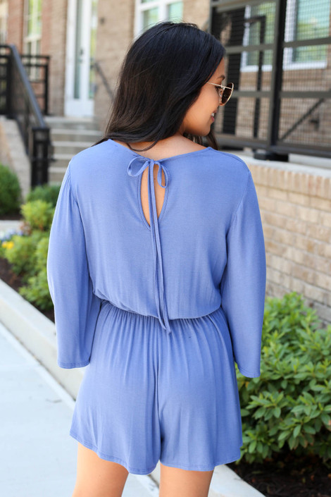 Model wearing Blue Soft Knit Wide Sleeve Romper Back View