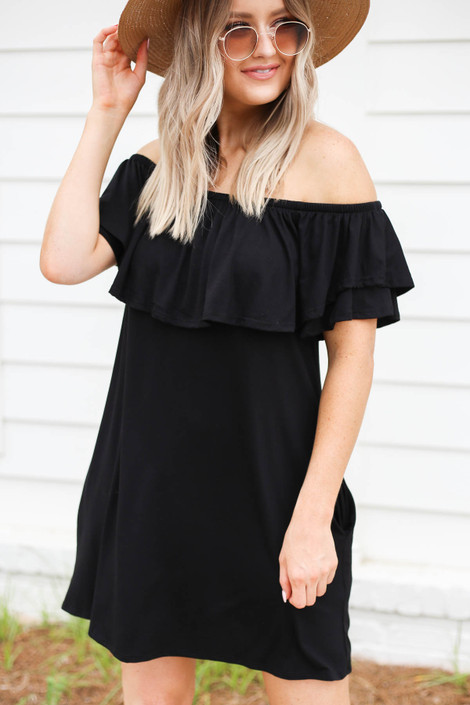 Model wearing Black Off the Shoulder Pocketed Mini Dress Front View