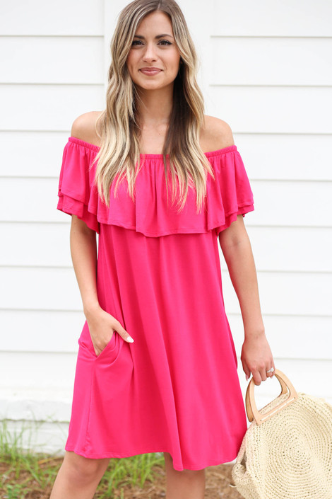 Model wearing Neon Pink Off the Shoulder Pocketed Mini Dress Front View
