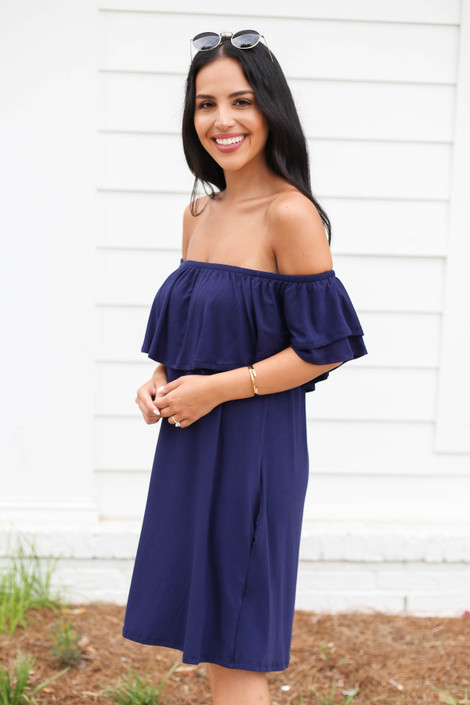 Model wearing Navy Off the Shoulder Pocketed Mini Dress Side View