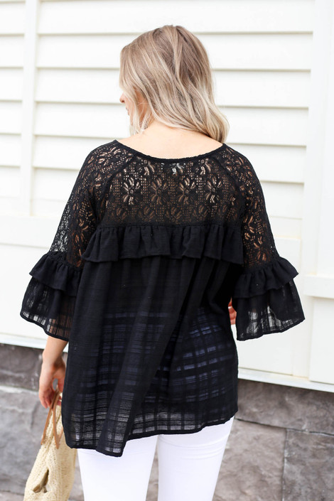 Model wearing Black Lace Ruffle Sleeve Blouse Back View