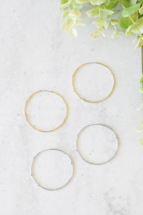 Gold - And Silver Skinny Hoop Earrings Flat Lay