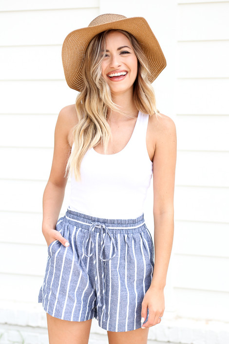 Model wearing Blue and White Striped Tie-Waist Shorts Side View