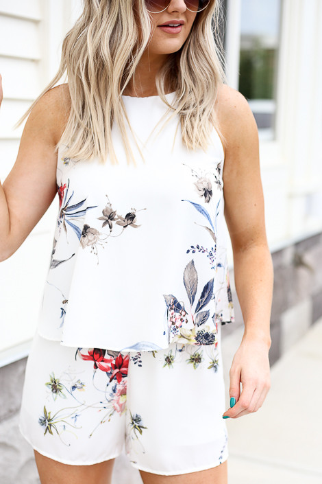 Model wearing Ivory Floral Romper Detail View