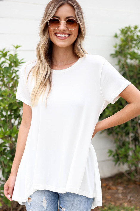 Model wearing White Exposed Stitch Tee
