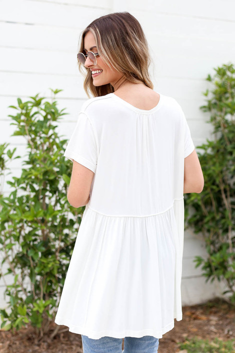 Model wearing White Exposed Stitch Tee Back View