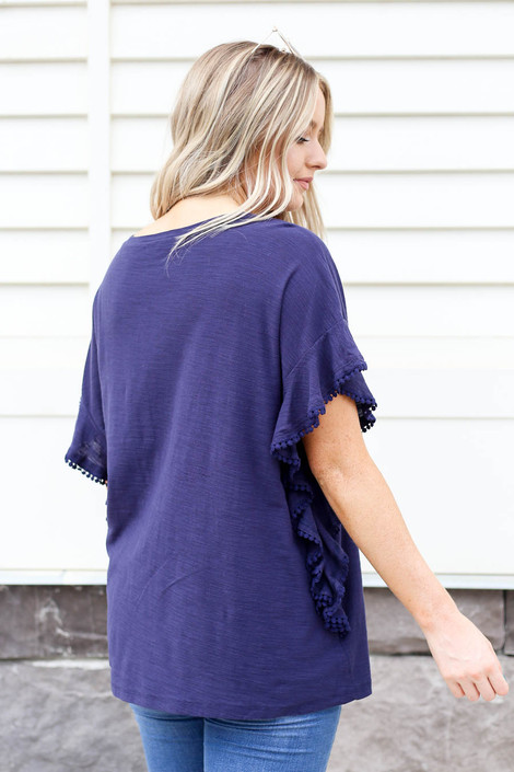 Model wearing Navy Ruffled Circle Lace Top Back View