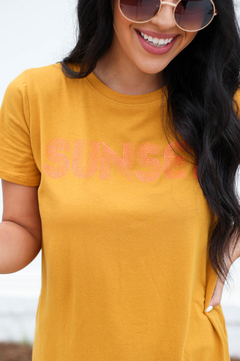 Mustard - Model wearing Mustard Sunset Graphic Tee Front View Detail View