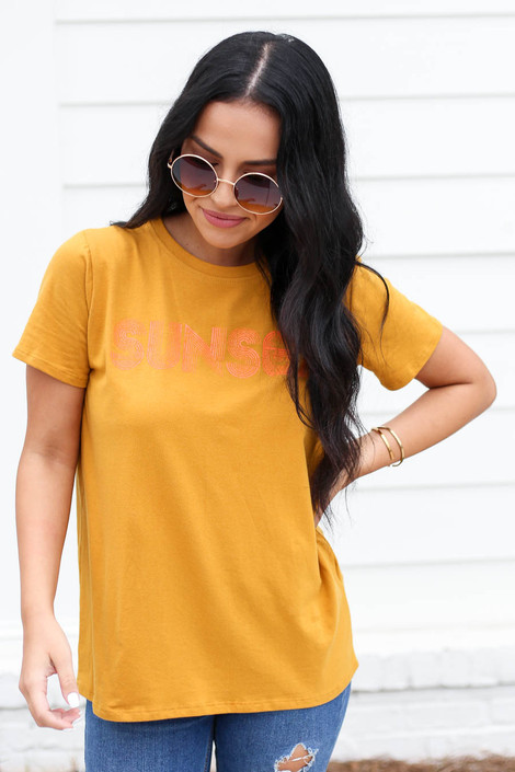Mustard - Model wearing Mustard Sunset Graphic Tee Front View