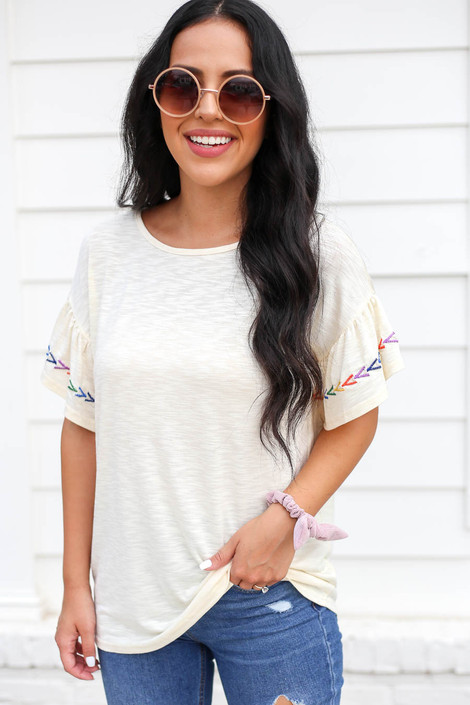 Model wearing Ivory Ruffle Embroidered Sleeve Top Front View
