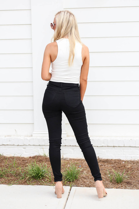 Model wearing Black Button Front Black High Waisted Jeans Back View