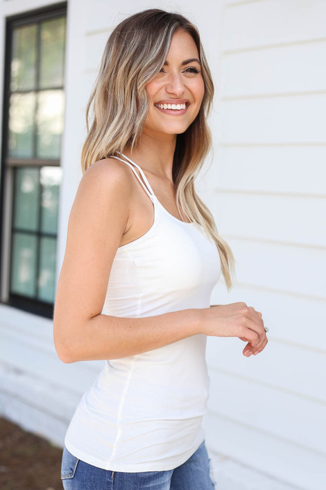 Model wearing White Ribbed Bodycon Criss-Cross Back Tank Top Side View