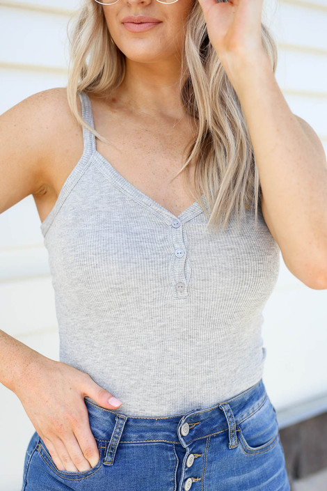 Model wearing Heather Grey Ribbed Button Up Bodysuit Detail View