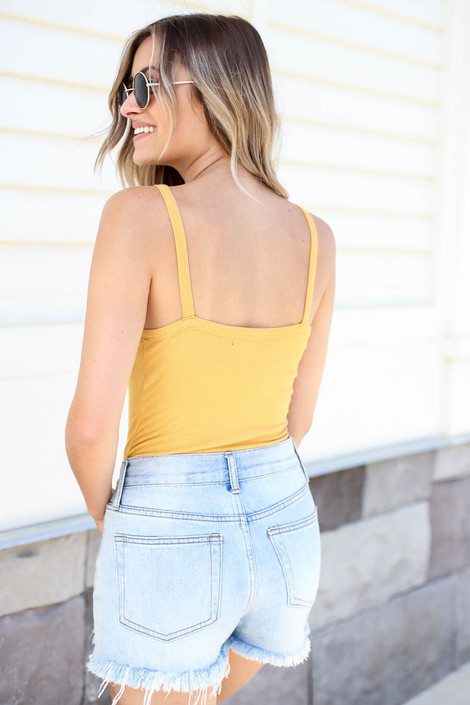Model wearing Mustard Ribbed Button Up Bodysuit Back View