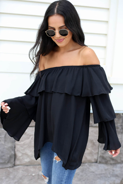 Model wearing Black Off the Shoulder Ruffled Sleeve Tiered Top Side View
