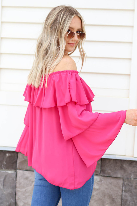 Model wearing Fuchsia Off the Shoulder Ruffled Sleeve Tiered Top Back View