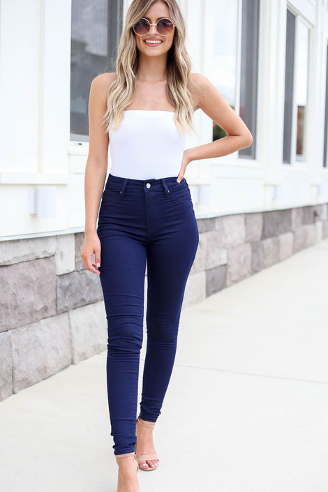Model wearing Dark Wash Skinny Jeans Front View