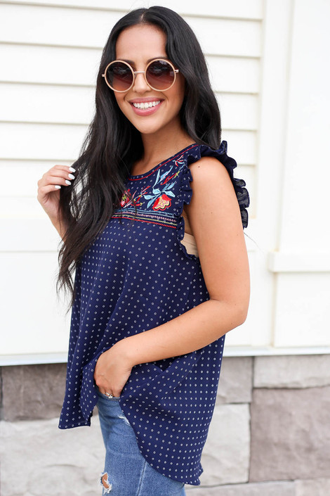Model wearing Navy Embroidered Ruffle Sleeve Top Side View