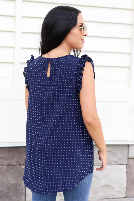 Model wearing Navy Embroidered Ruffle Sleeve Top Back View