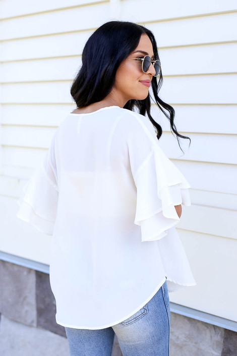 Model wearing White Ruffle Sleeve Blouse Back View