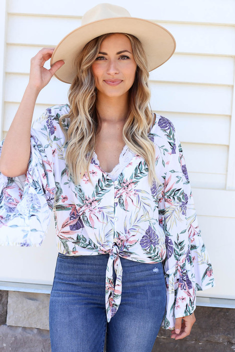 Model wearing White Floral Bell Sleeve Tie-Front Blouse