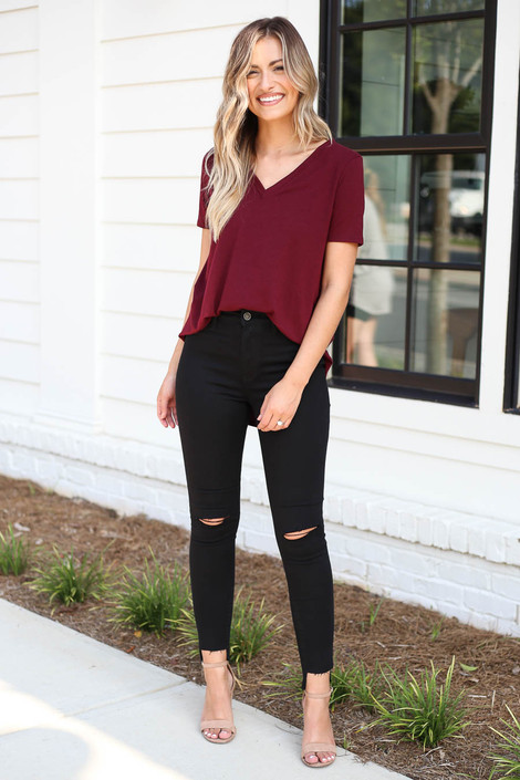 Model wearing Black Split Knee Step Hem Jeans Front View
