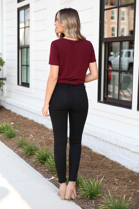 Model wearing Black Split Knee Step Hem Jeans Back View