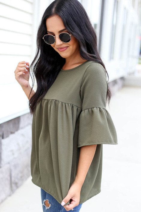 Model wearing Olive Babydoll Bell Sleeve Blouse