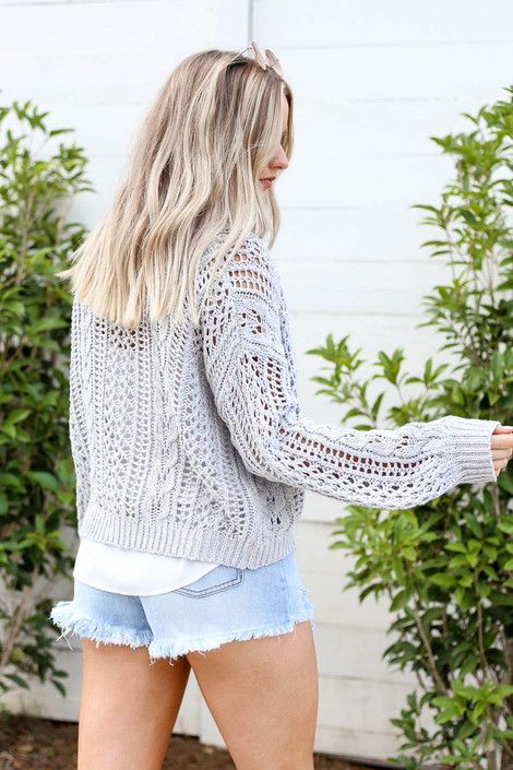 Model wearing Grey Cropped Cable Knit Cardigan Back View