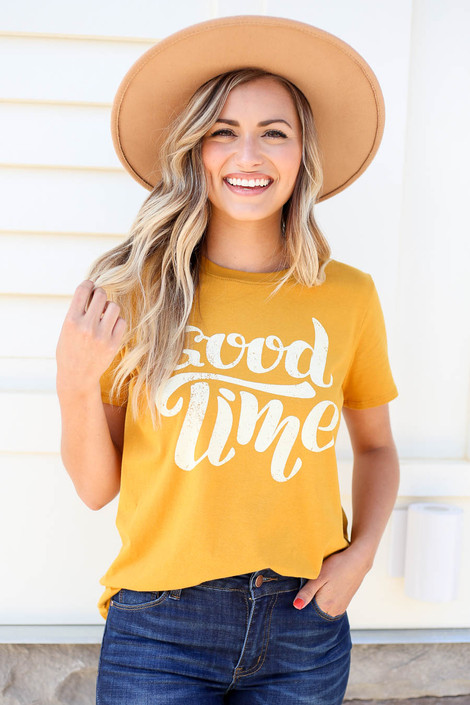 Model wearing Mustard Good Time Graphic Tee Tucked In