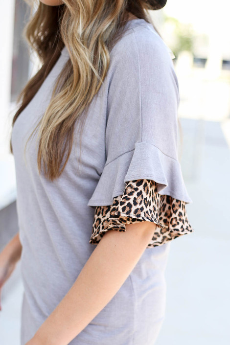 Model wearing Grey Ruffle Sleeve Top with Leopard Trim Detail View