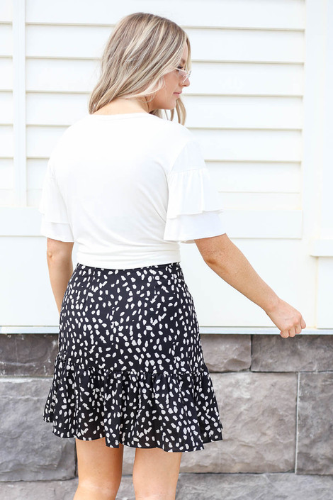 Model wearing Black Spotted Ruffle Skirt Back View