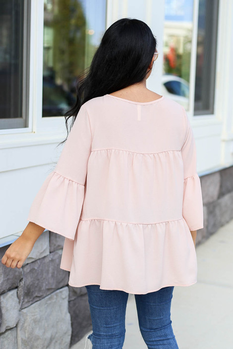 Model wearing Blush Tiered Ruffle Sleeve Top Back View