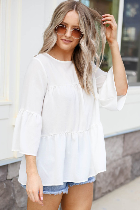 Model wearing White Tiered Ruffle Sleeve Top Side View