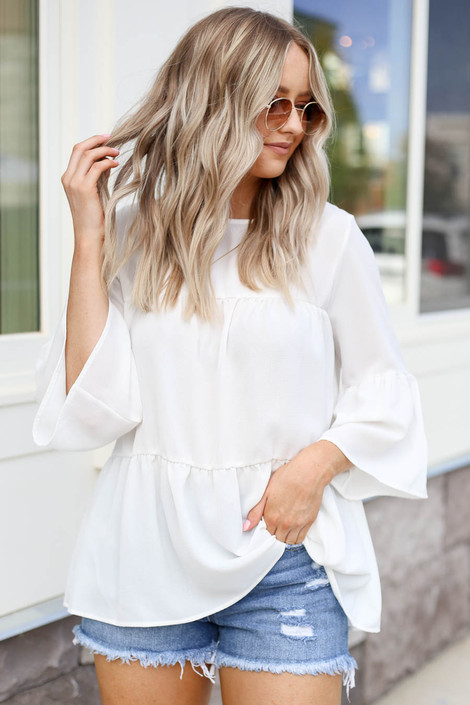 Model wearing White Tiered Ruffle Sleeve Top