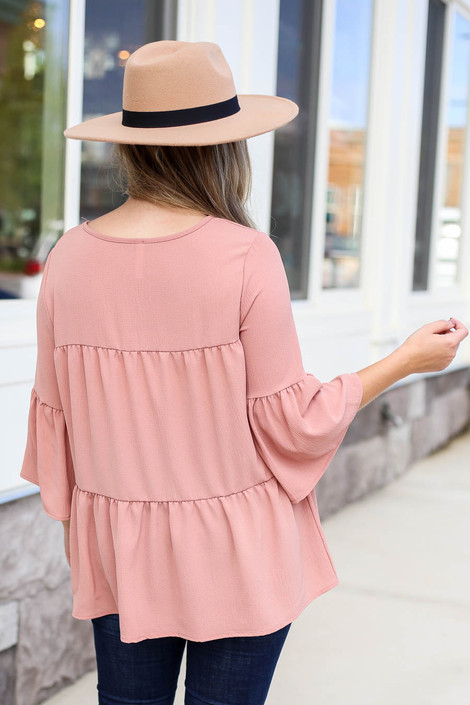 Model wearing Mauve Tiered Ruffle Sleeve Top Back View