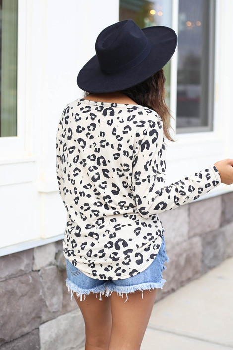 Model wearing Ivory Leopard Print Tie-Front Top Back View