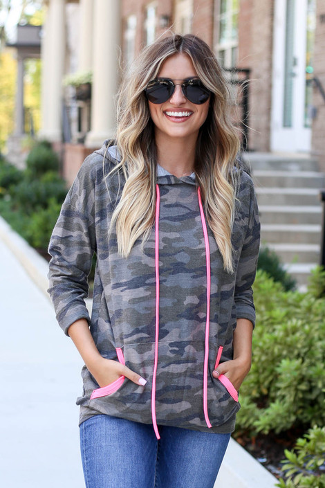 Camo - Model wearing Camo Soft Knit Hoodie with Pink Accents Front View
