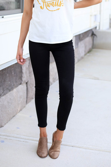 Model wearing Black Mid-Rise Skinny Jeans Front Detail View