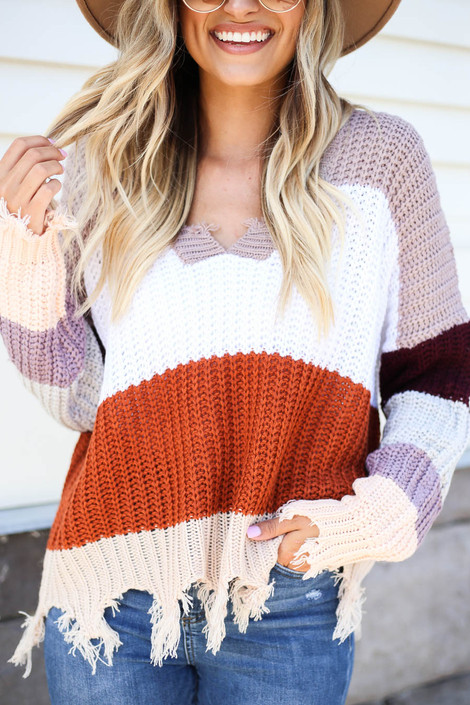 Model wearing Taupe Striped Distressed Sweater Detail View