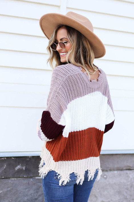 Model wearing Taupe Striped Distressed Sweater Back View