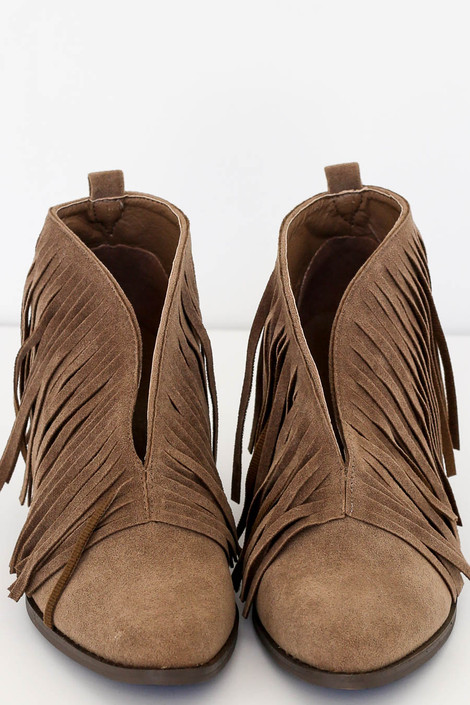 Flat Lay of Taupe V-Cut Fringe Booties Top View